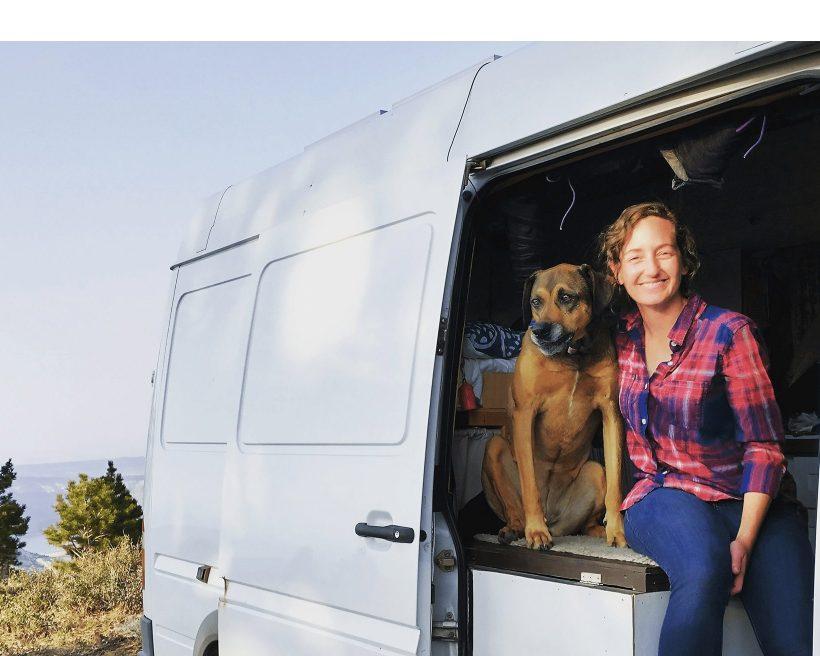 Jenny and her dog Dakota in the van.