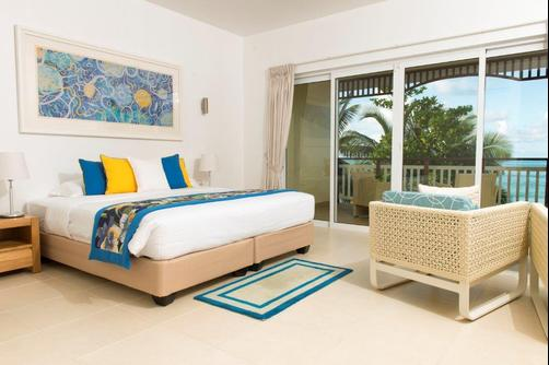 Acajou Beach Resort - Praslin Island - King bedroom