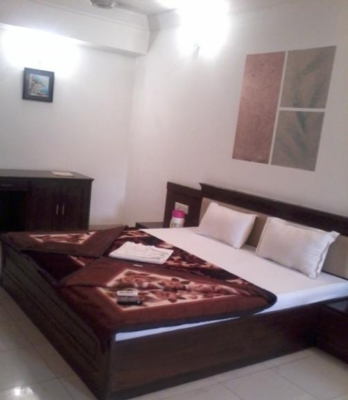 Hotel Orchid 24x7 - Ahmedabad - Bed