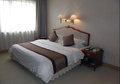 Silver Star Hotel - Korla - Bed