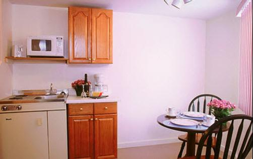 Garrison Suites, Motel and Cottages - Wells - Kitchen